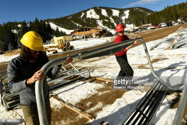 NEDERLAND CO NOVEMBER 9 Lift operators Kenny Karsten left and William Strauss right work on assembling the new chairs to be put on the new...