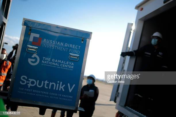 Lift truck carries a box of vaccines during the arrival of the first 20,000 doses of Sputnik V vaccine from Russia at El Alto International Airport...