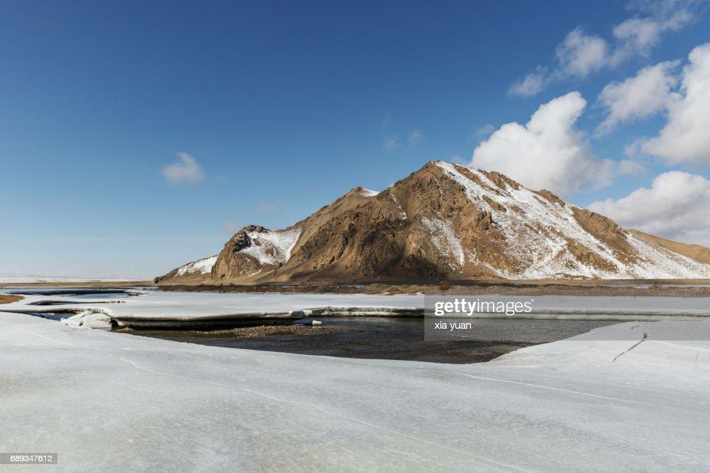 Lifted ice plates on floating river on Bayanbulak,China : Stock Photo
