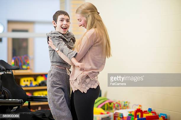 Lifting a Disabled Child Out of His Wheelchair