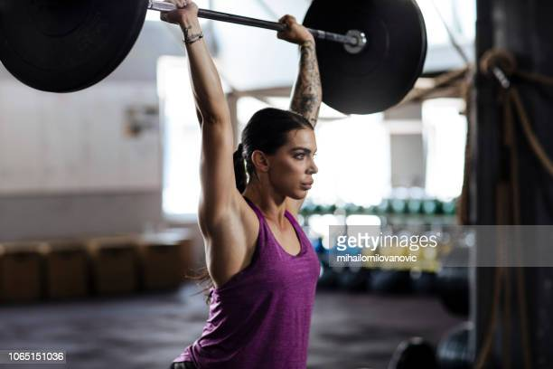 lifting barbell - crossfit stock pictures, royalty-free photos & images
