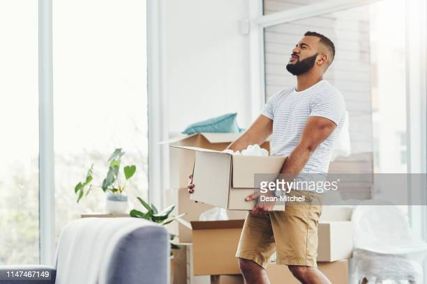lifting heavy items can result in injury to your muscles - picking up stock pictures, royalty-free photos & images