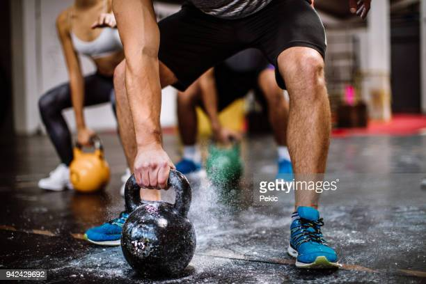 lifting kettle bells - mass unit of measurement stock pictures, royalty-free photos & images