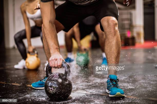 lifting kettlebells - crossfit stock pictures, royalty-free photos & images