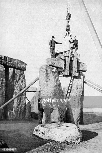 Lifting of an impost at Stonehenge Restoration of the ancient monument The Stonehenge complex on Salisbury Plain in Wiltshire evolved in a series of...