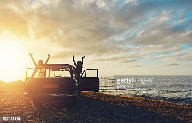 lifting the sun - road trip stock photos and pictures