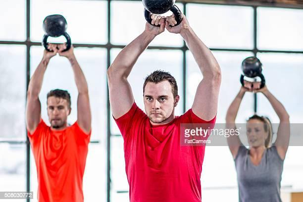 lifting weights at the gym - overheadprojector stockfoto's en -beelden