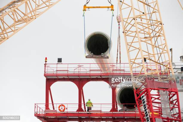 Lifting wind turbine blades onto a jack up barge to build the walney offshore wind farm.