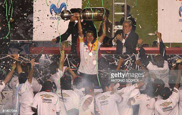 Liga Deportiva footballers celebrate their victory in the Libertadores Cup final match July 02 2008 after defeating Fluminense in the Libertadores...