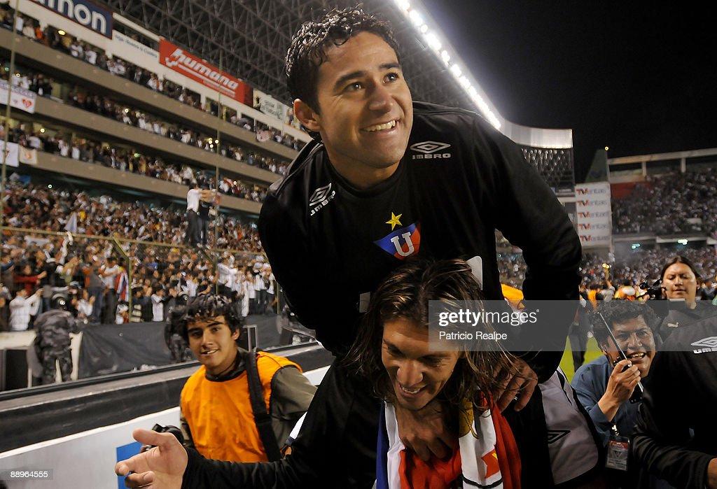 Liga Deportiva Universitaria's Claudio Bieler celebrates after the team's victory against Internacional in a 2009 South American Recopa soccer match at the Casa Blanca Stadium on July 9, 2009 in Quito, Ecuador. LDU won 3-0.