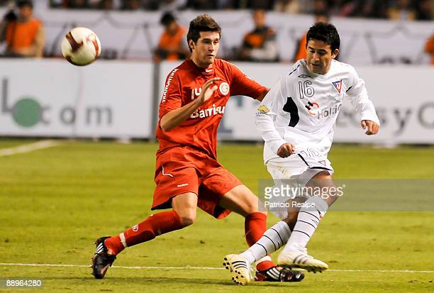 Liga Deportiva Universitaria's Claudio Bieler vies for the ball with Internacional's Danny during a 2009 South American Recopa soccer match at the...