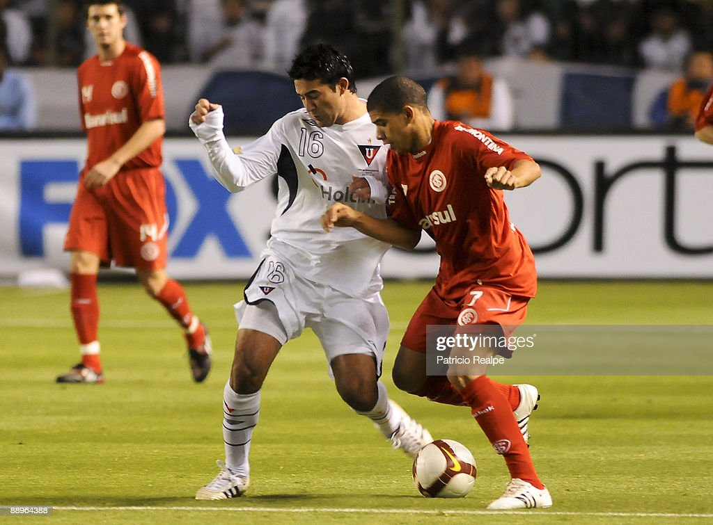 Liga Deportiva Universitaria's Claudio Bieler (L) vies for the ball with Internacional's Taison during a 2009 South American Recopa soccer match at the Casa Blanca Stadium on July 9, 2009 in Quito, Ecuador.