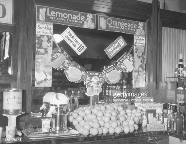 Ligget's Drug Store at 29 S Pinckney Street with a lemonade display on the soda fountain Madison Wisconsin August 14 1934 The signs on the mirror...