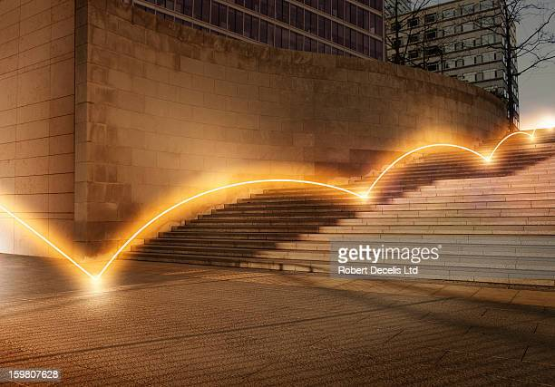 ligh trail bouncing down steps. - direction stock pictures, royalty-free photos & images