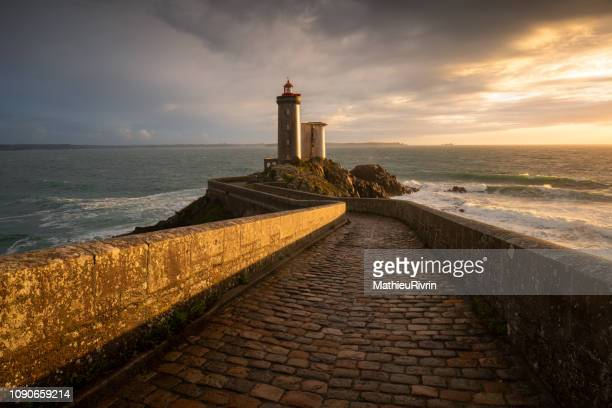 """light after storm - amazing lighthouse """"petit minou"""" in bretagne - brest brittany stock pictures, royalty-free photos & images"""