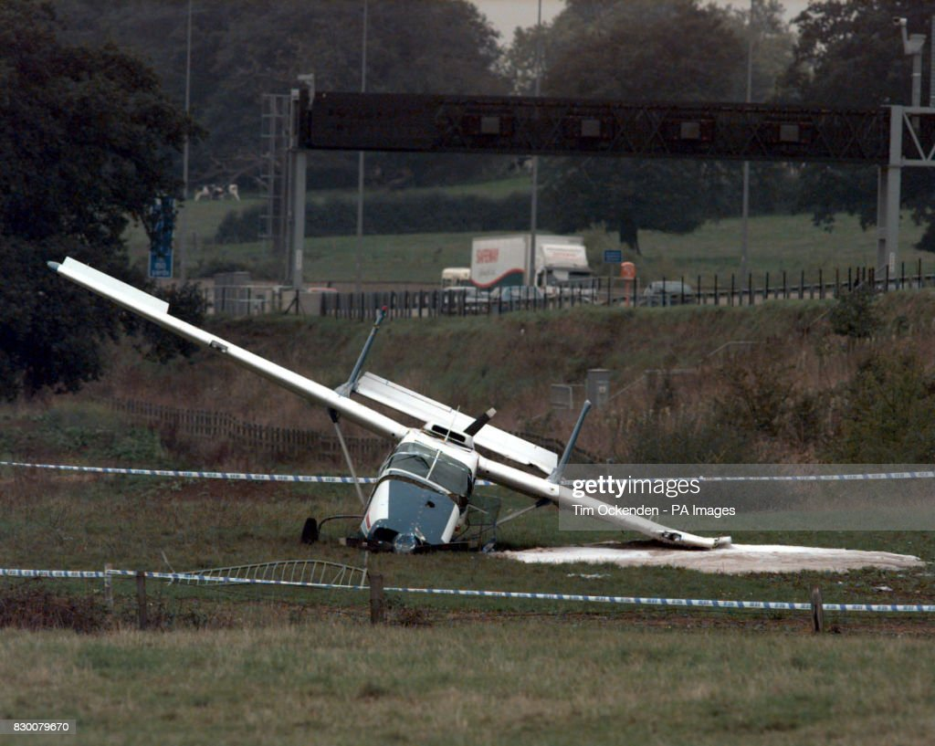 A light aircraft lies wrecked, after crashing just yards from the