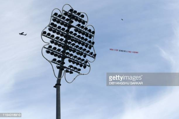 A light aircraft tows a banner with the words India Stop Genocide Free Kashmir in the sky above the ground during the 2019 Cricket World Cup group...