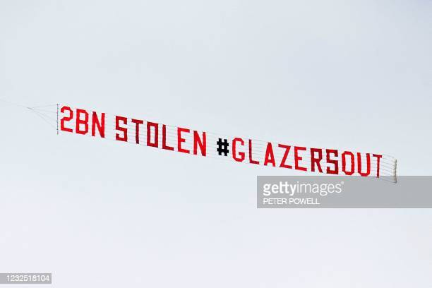 "Light aircraft tows a message saying "" 2BN STOLEN GLAZERSOUT"", as protests against the Manchester United owners continue, ahead of the English..."