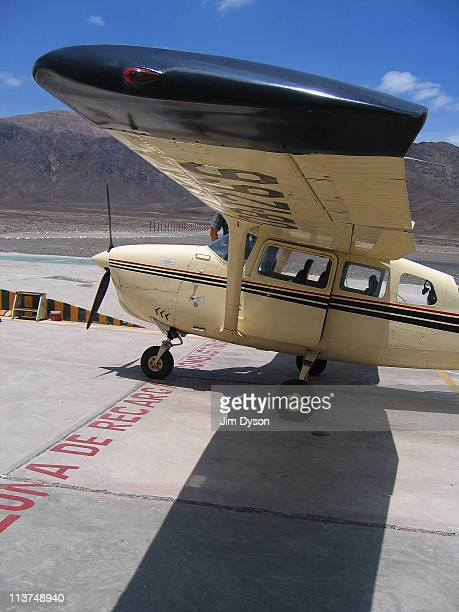 A light aircraft waits to transport tourists over the ancient and mysterious Nazca Lines in the Nazca Desert on March 9 2005 in Nazca Peru The lines...