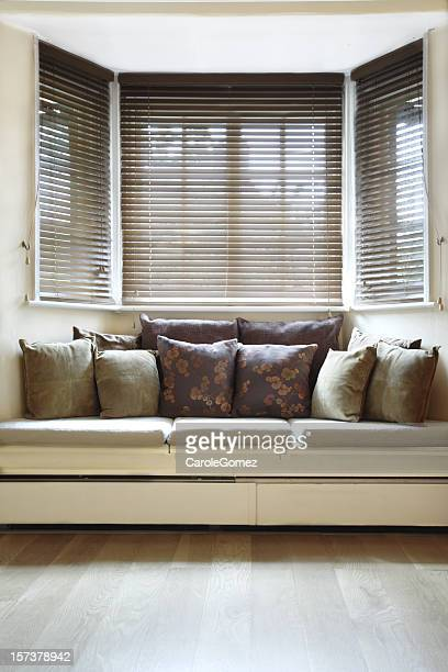 light and airy room with wooden blinds - erker stockfoto's en -beelden