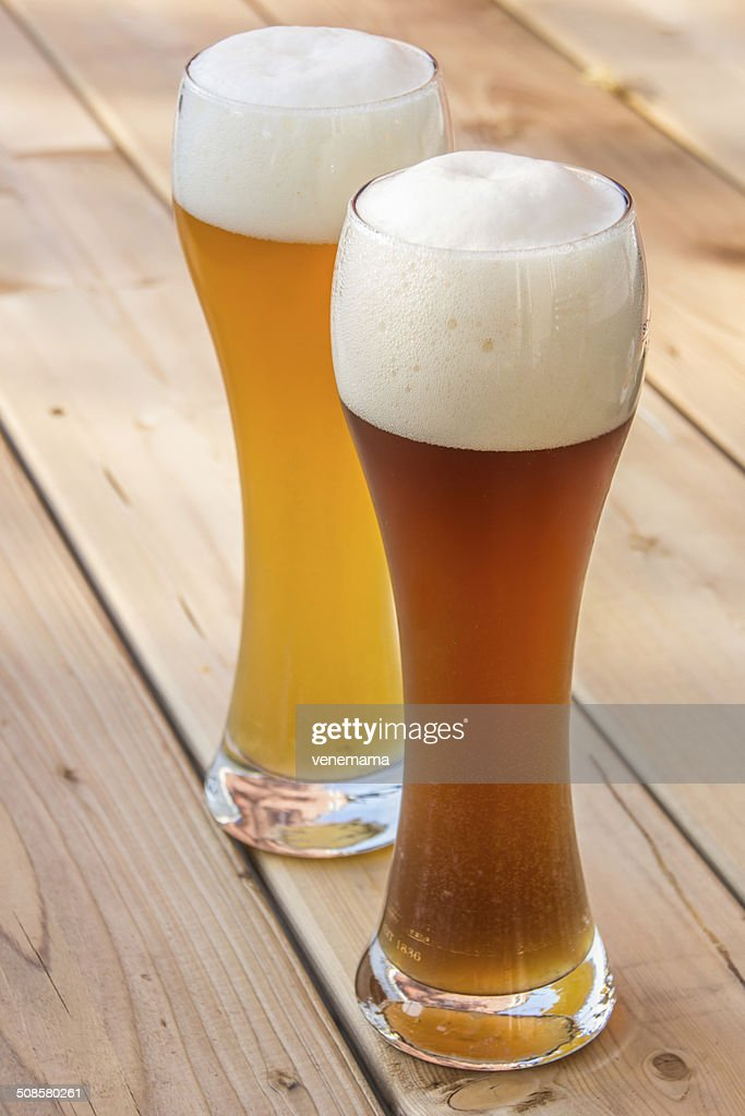 Light and dark German wheat beer : Stock Photo