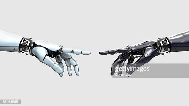 light and dark robot hands pointing at each otherl