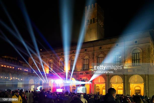 light and music show in front of palazzo del podesta at new year in bologna. - emreturanphoto stock pictures, royalty-free photos & images