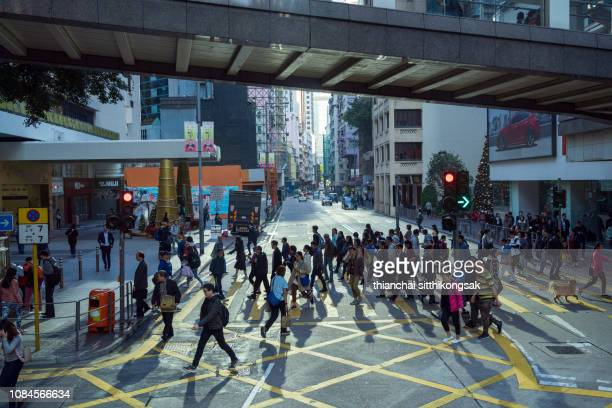 Light and shadow of people walking crosswalk at Hong Kong business area
