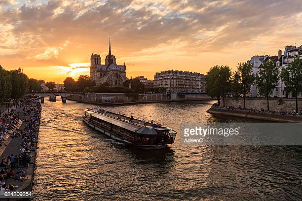 Light and shadow on Seine River with Notre dame de Paris in background during sunset