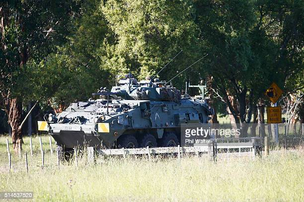 Light armoured tanks at the scene on the outskirts of Kawerau on March 10 2016 in Rotorua New Zealand Four police officers were shot and injured...