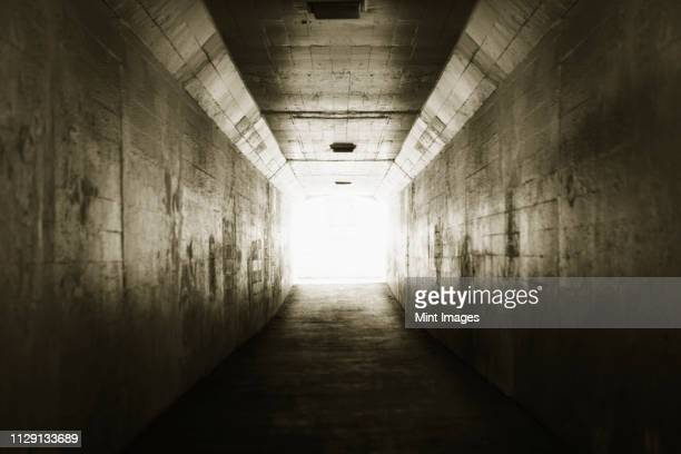light at the end of a tunnel - light at the end of the tunnel stock pictures, royalty-free photos & images
