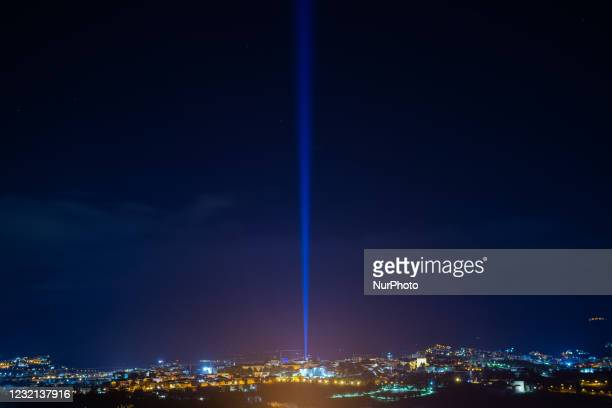 Light beam shining during ceremony of 12th anniversary of earthquake in L'Aquila, Italy, on April 5, 2021. The 12th anniversary of the L'Aquila...