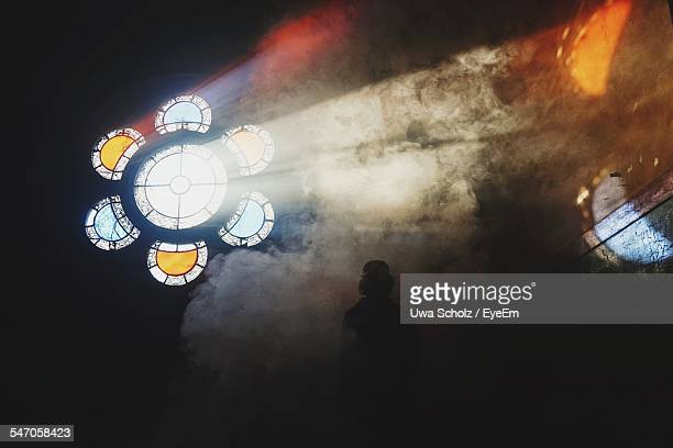 Light Beam Through Circular Stained Glasses In The Dark