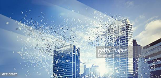 light beaming from exploding modern highrises - disintegration stock photos and pictures