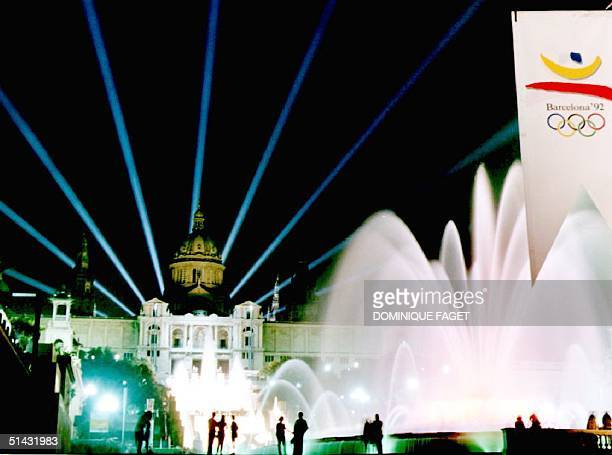 Light beams cross the sky over the 'Font Magica' fountain and the Palau Nacional late 16 July 1992 as the city gives the last touch to its main...