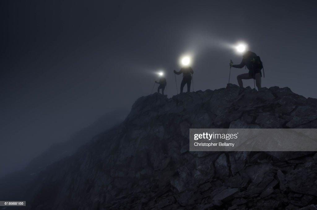 Light beams on mountain ridge : Stock Photo