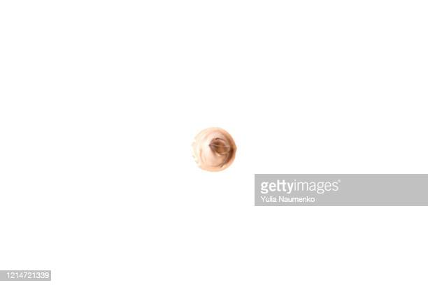 light beige smear of tone cream, liquid smear, highlighter isolated on white background. makeup smear of creamy foundation isolated on white background. creamy foundation texture isolated on white. - face mask beauty product stock pictures, royalty-free photos & images