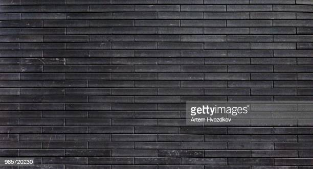 light black brick wall background - brick wall stock pictures, royalty-free photos & images