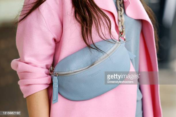 Light blue hip bag by Tiefenbacher Lehmann as a detail of german singer Jasmin Wagner during a street style shooting on May 1, 2021 in Hamburg,...