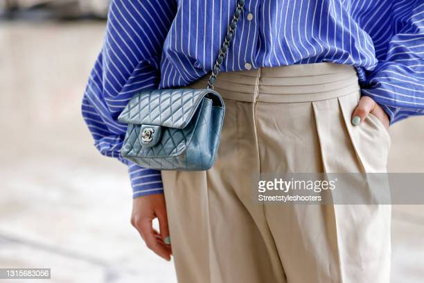 Light blue mini vintage bag by Chanel as a detail of German singer Jasmin Wagner during a street style shooting on May 1, 2021 in Hamburg, Germany.