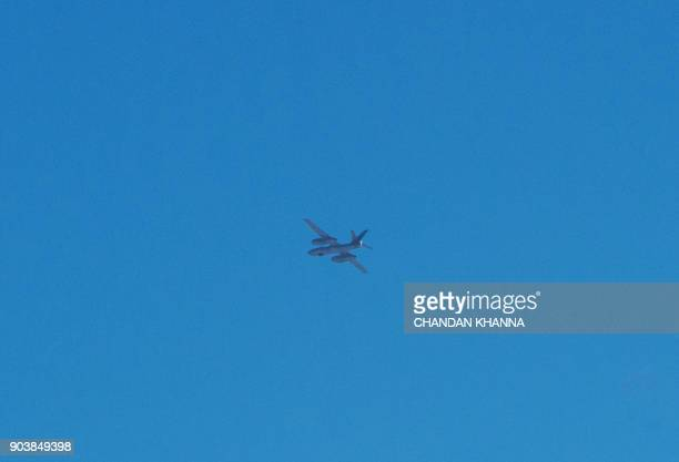 A light bomber aircraft identified as either an Ilyushin Il28 or its Chinese copy known as the H5 flies over the North Korean town of Sinuiju as seen...