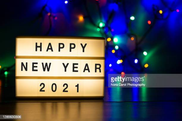 light box with text happy new year 2021 with christmas light - new year's eve stock pictures, royalty-free photos & images