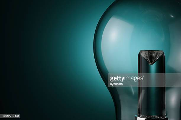 LED light bulb against blue background with copy space