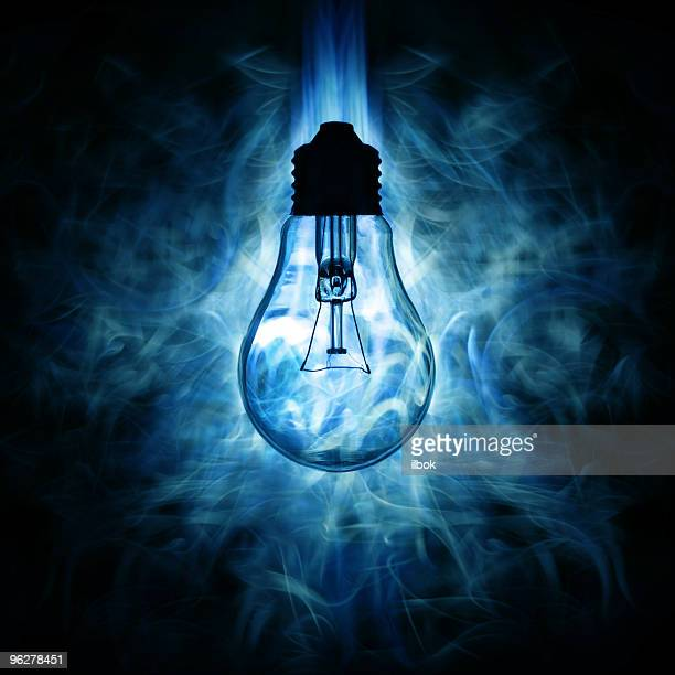 Light bulb and blue smoky light background