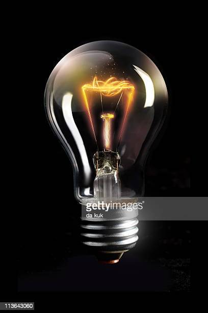 light bulb concept - filament stock photos and pictures