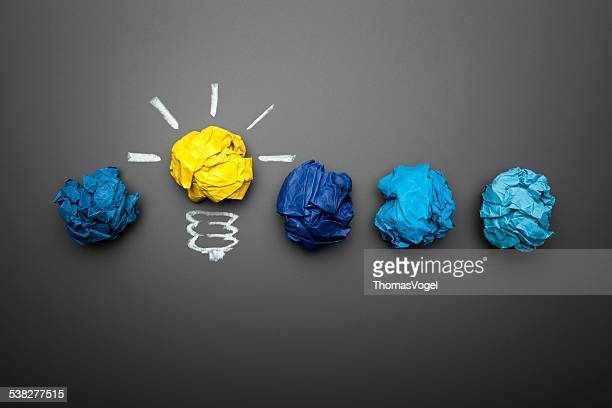light bulb crumpled paper on blackboard - idea concept background - symbol stock pictures, royalty-free photos & images