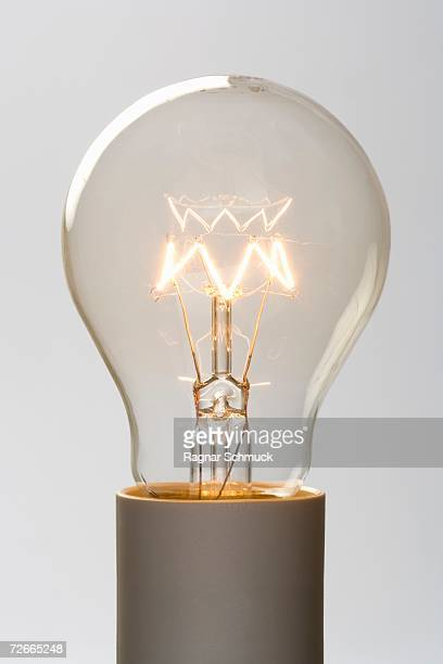 Light bulb filament glowing