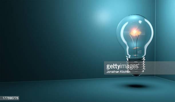 light bulb glowing - light bulb stock pictures, royalty-free photos & images