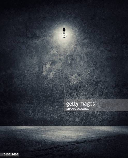 light bulb hanging from ceiling in empty space - darkroom stock pictures, royalty-free photos & images