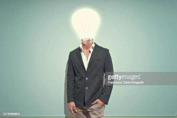 light bulb head - initiative stock pictures, royalty-free photos & images